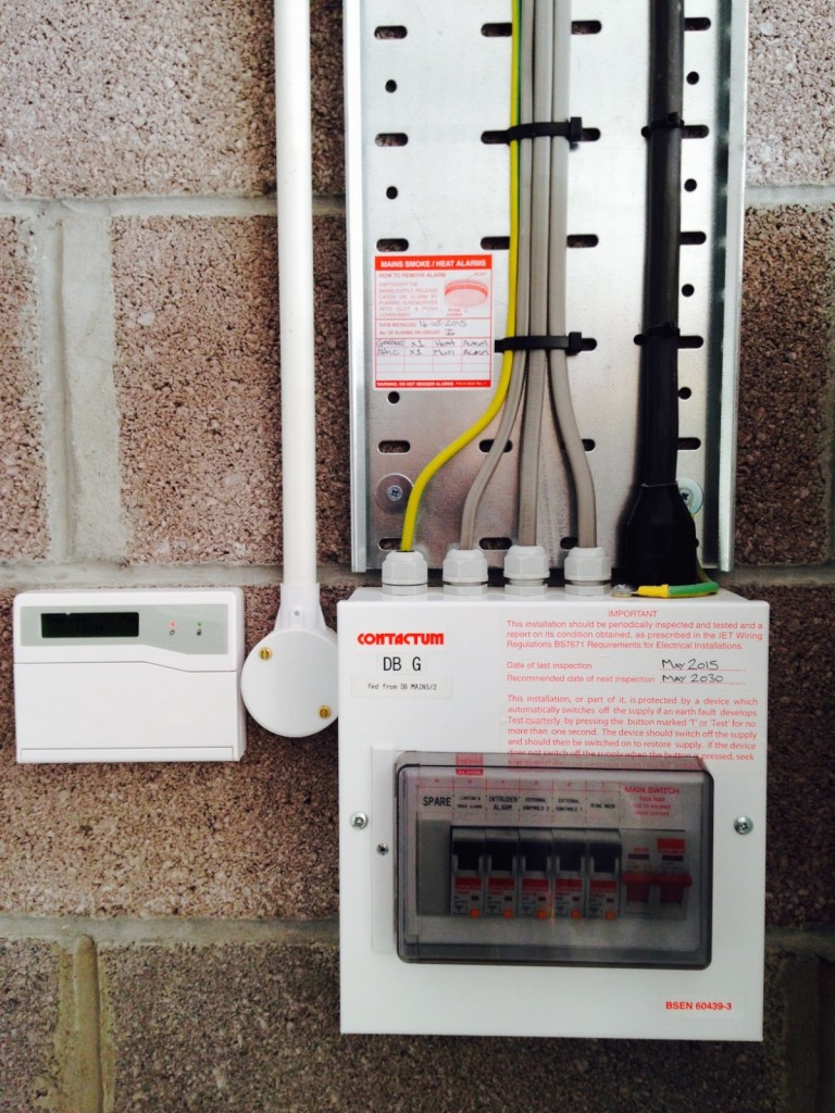 Garage consumer unit and remote alarm key pad